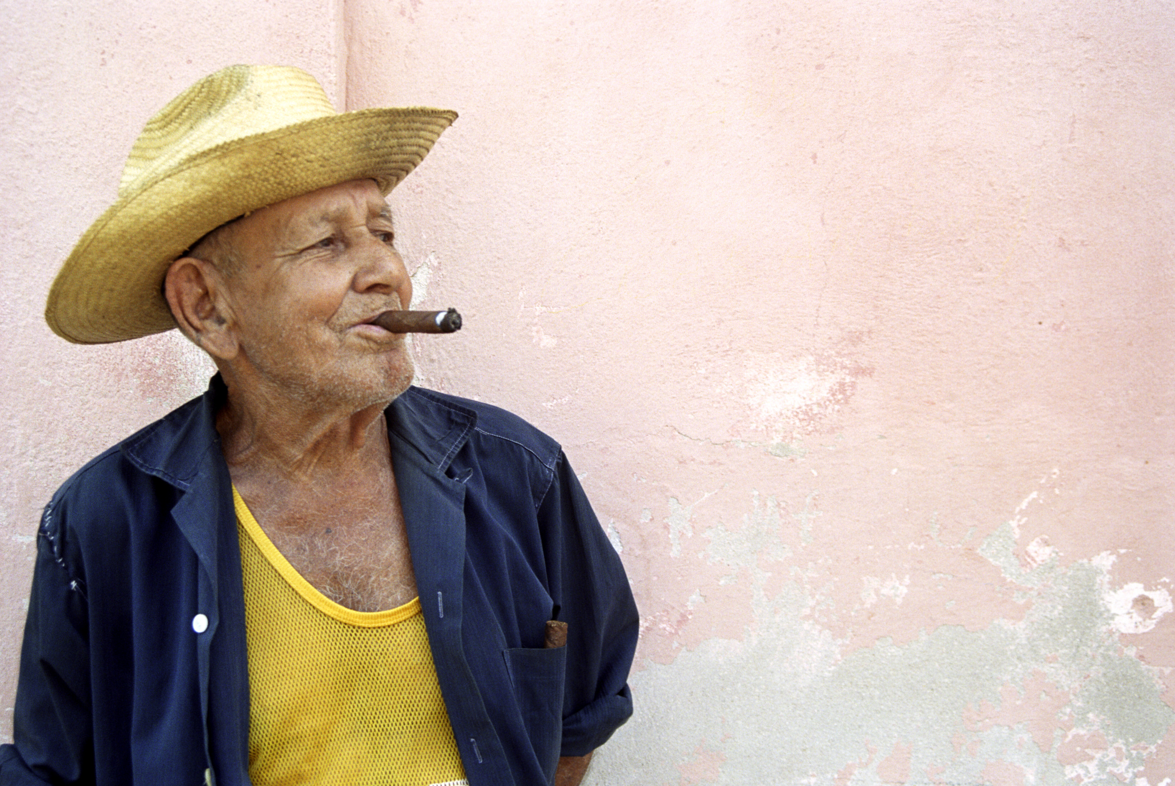 Cuba, Trinidad, senior man smoking cigar, looking away